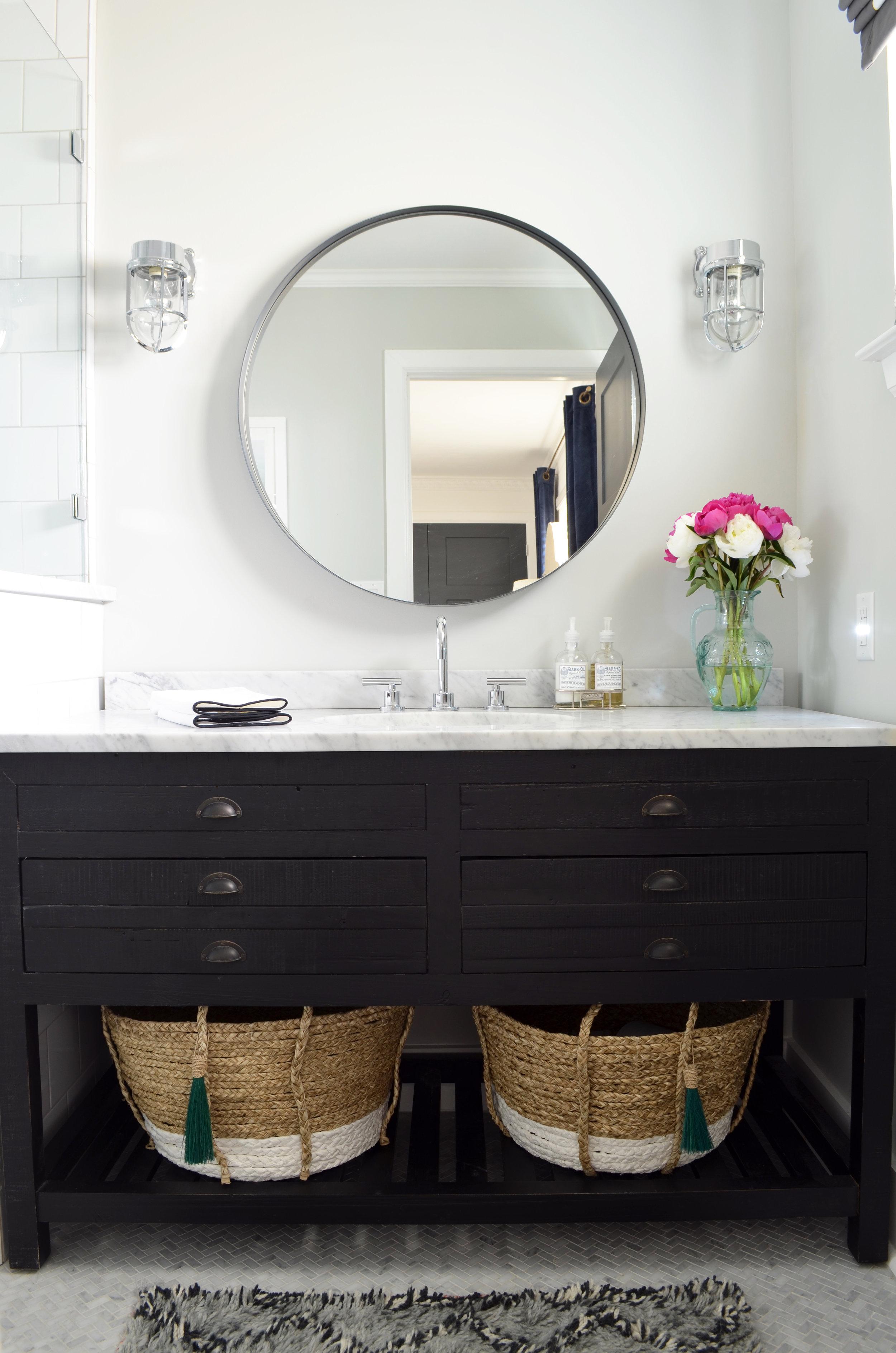 dark wood vanity with marble countertop.jpg