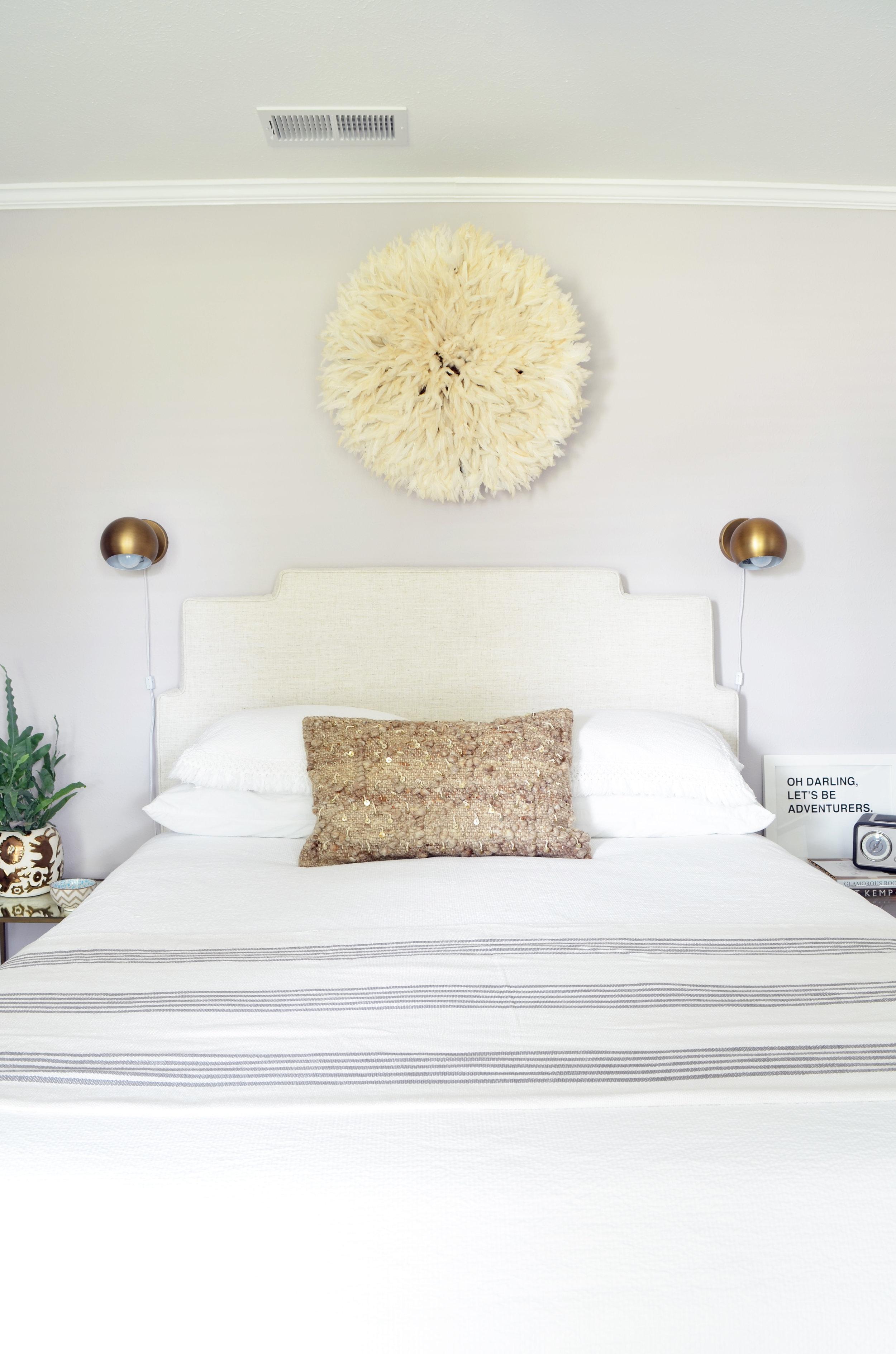 guest bedroom juju hat above bed.jpg
