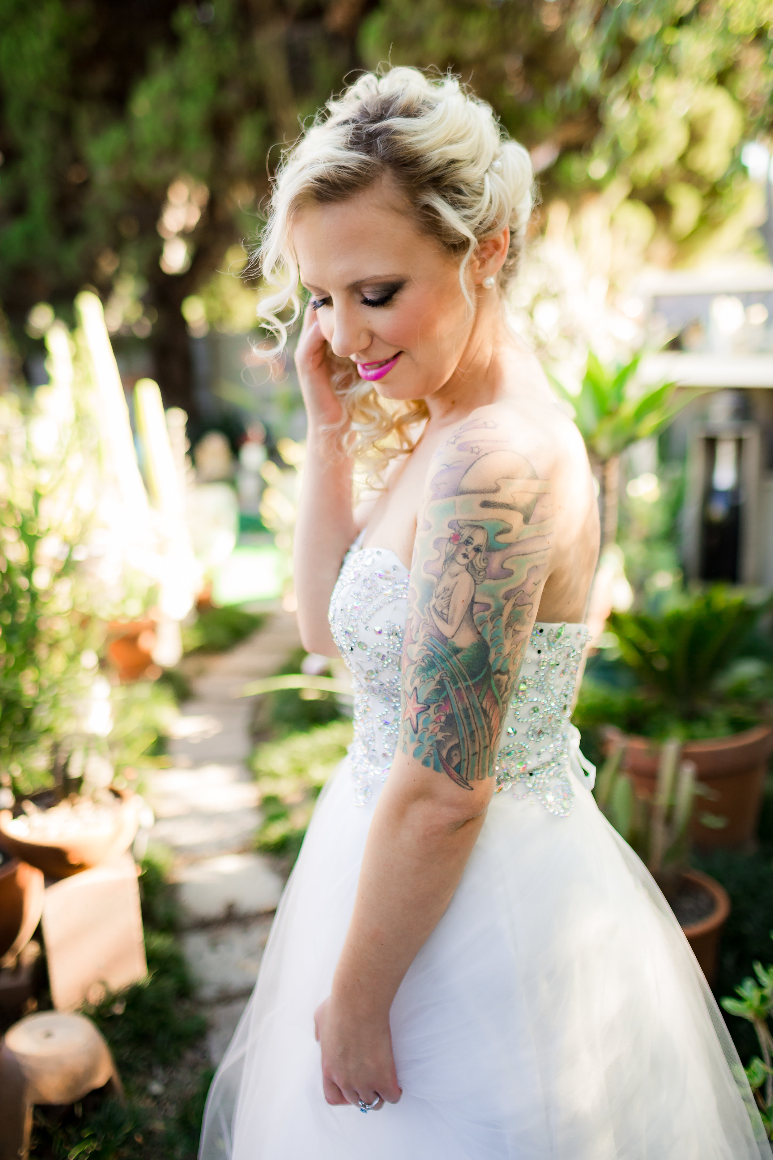 Edgy Bride with tattoos in her Wedding Dress
