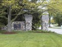 The natural stone pillars serve as an inviting gateway to the residential areas connected to Fox Chase Boulevard.