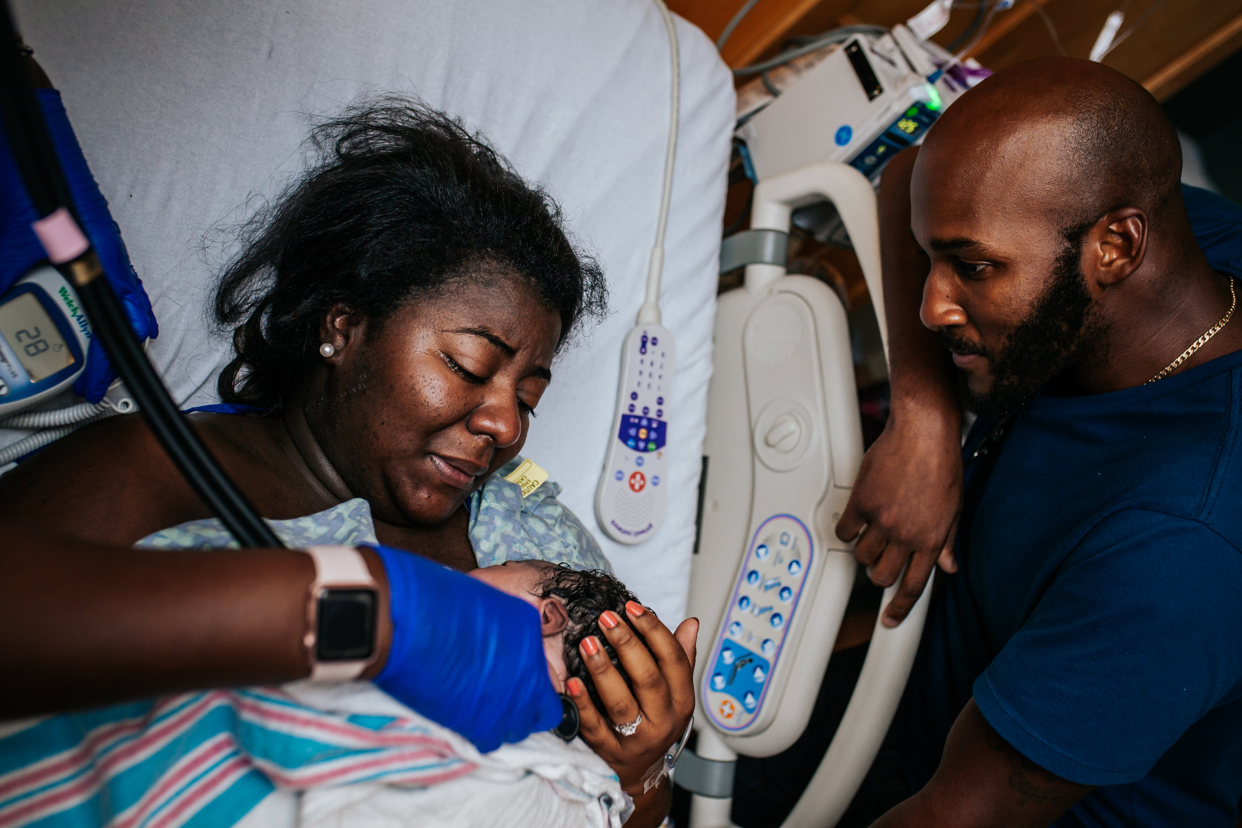 The sweetest moment, taking in her son's face. Birth with Dr Esses at Sacred Heart on the Emerald Coast.