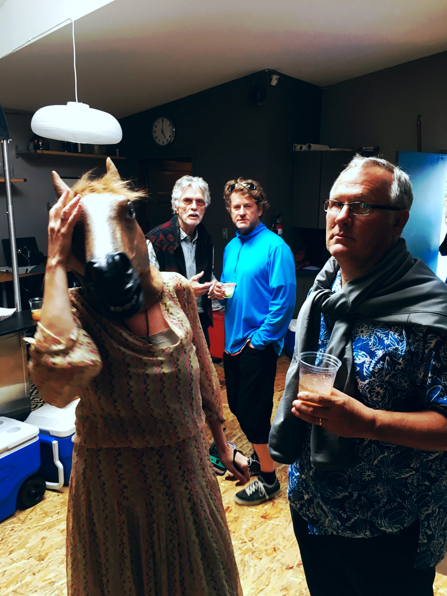 Brad Lenz and Tom Skerritt look on in confused bemusement as Chris Karges enjoys a beverage while lovely Mary Karges, (post-equine facial reconstruction surgery.) weeps for the bicycle seats.
