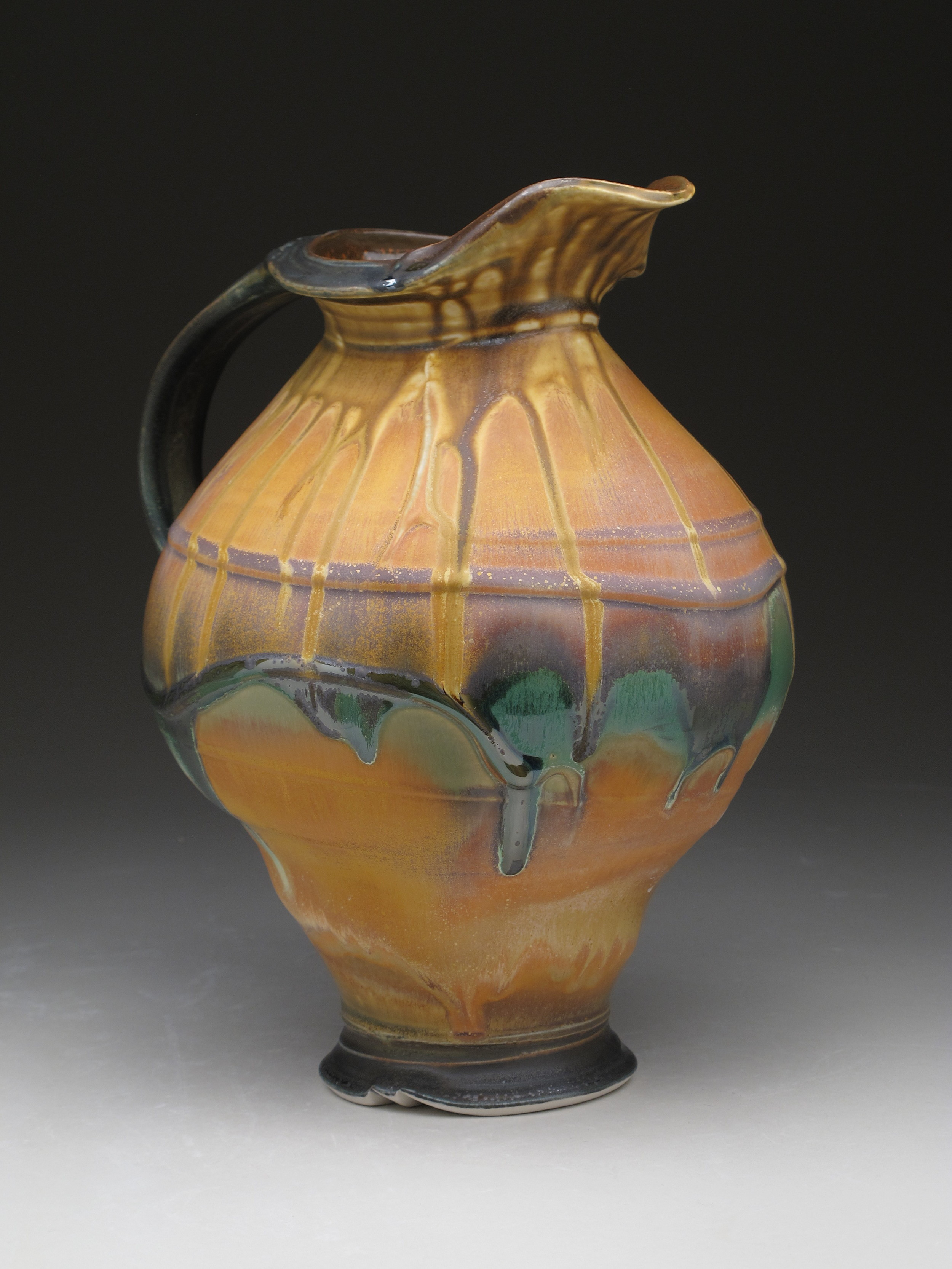 """Melon Pitcher, thrown and altered, ribbed slip design, multiple glaze application, ^8 electric fired, 12"""" x 9"""" x 8"""", 2015"""