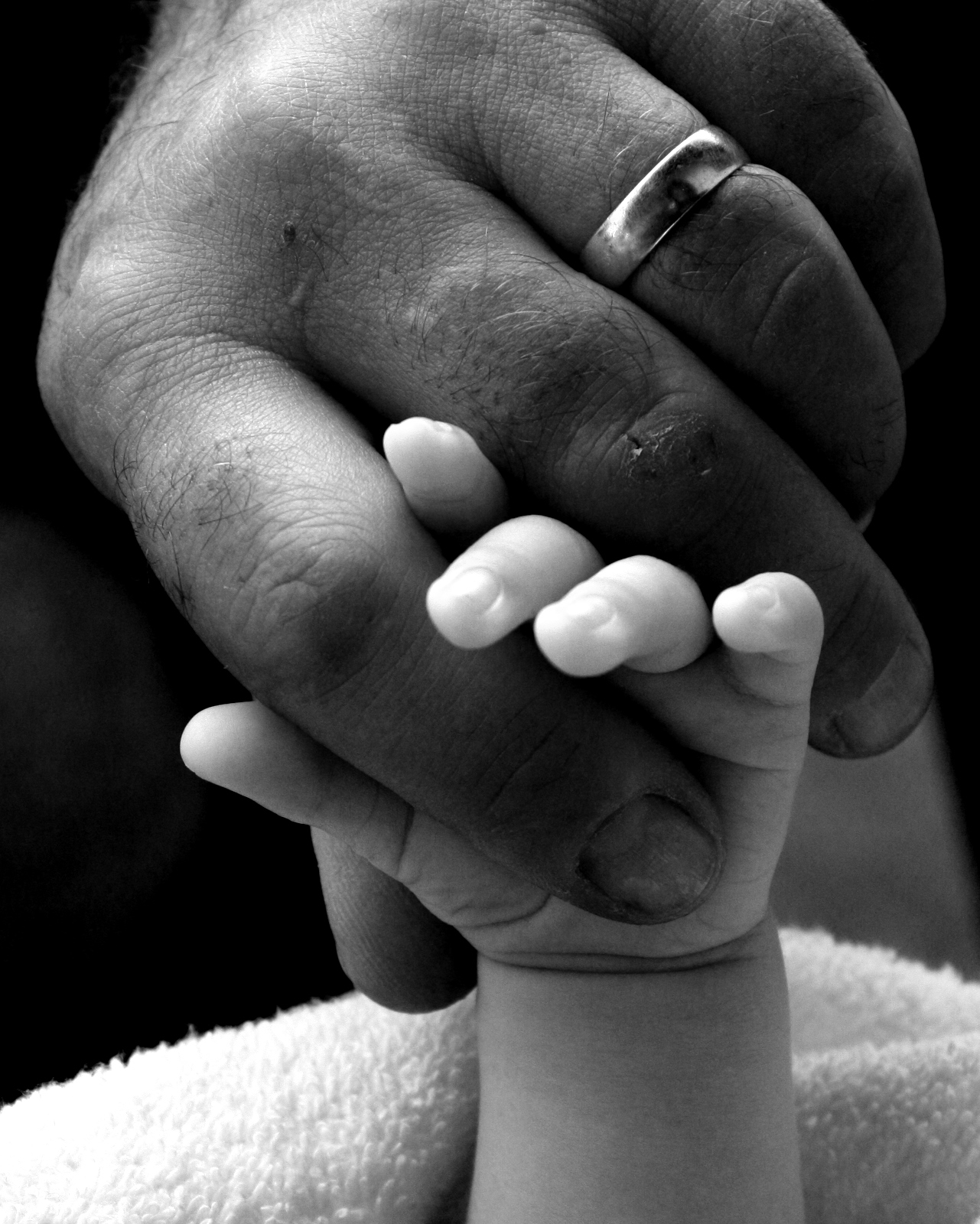 child with father's hand.jpg