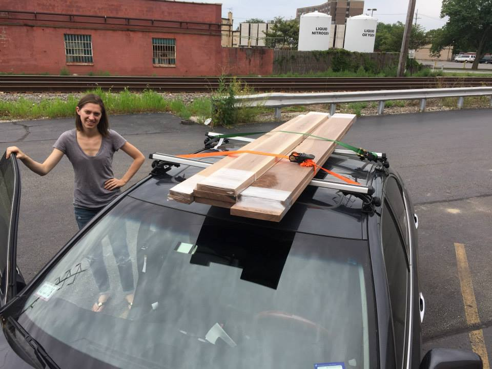 Terrible picture of me, but lugging our walnut wood home on the roof rack!