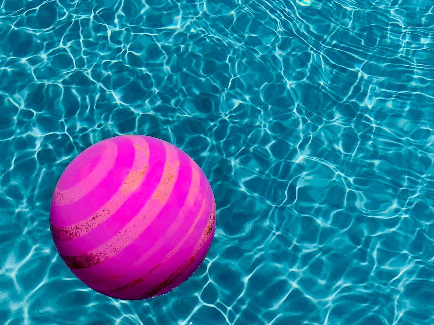 While I was photographing the fence, I spotted a couple of balls near the pool and a pink one caught my eye. This client has a great pool that is so clean and neat that it was just begging to be photographed. I threw the bright pink ball into the vibrant, blue water and I loved the contrast in the colors. I took quite a few different shots but I only really liked one. This is the photo I will be submitting for the contest.  26mm - 1/4,300 - f/1.8 - ISO 25