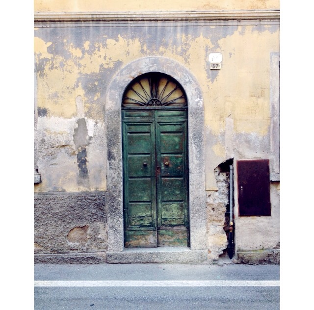 Doorway, Brienno. Everythings a bit worn and tatty in the area but it's all part of the rustic Italian feel.