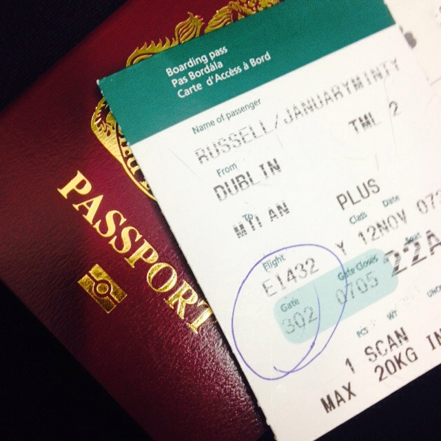 Passport and boarding card ready for Milan
