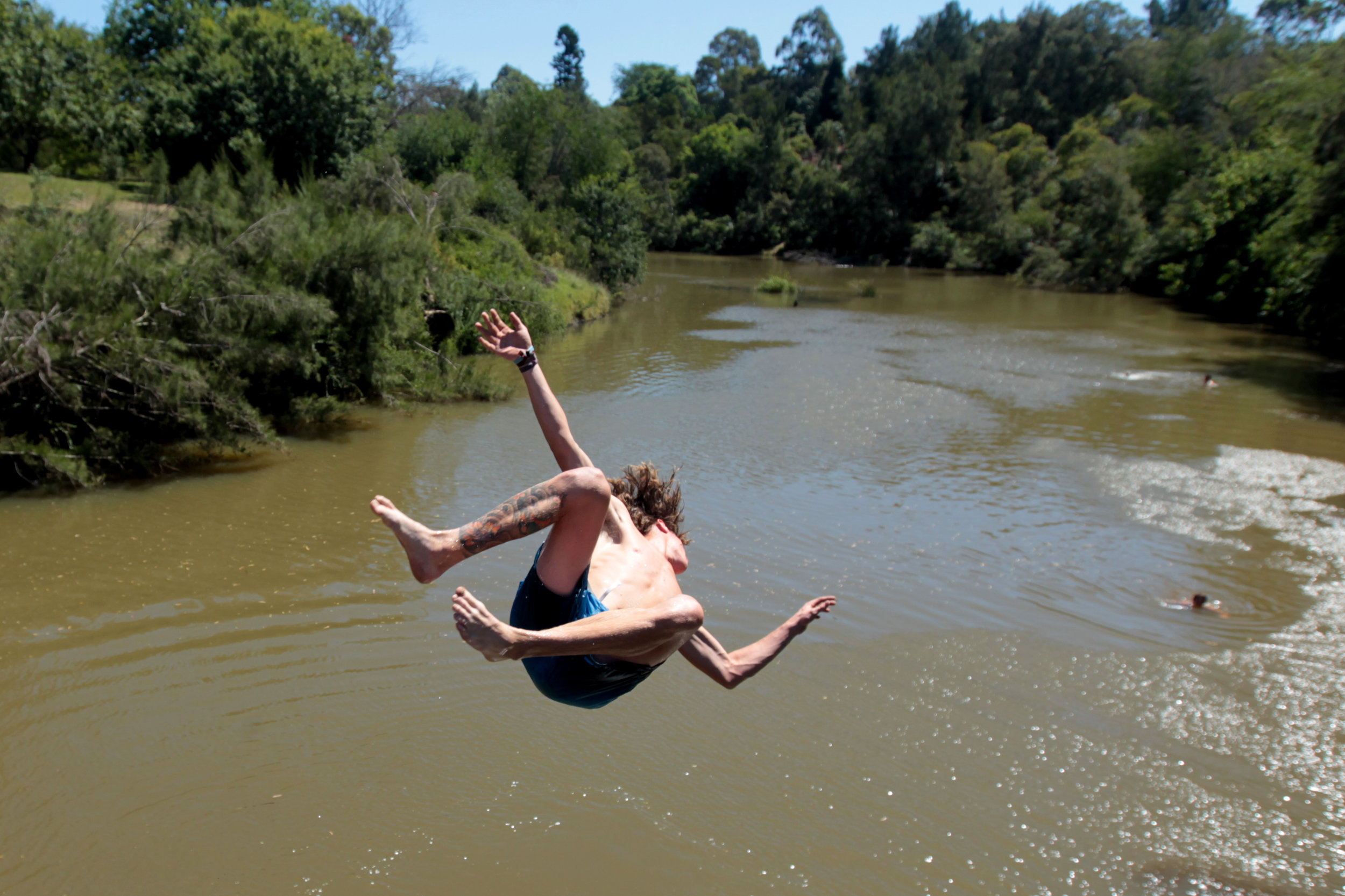 Camden locals cooling off in the Nepean River at Camden.