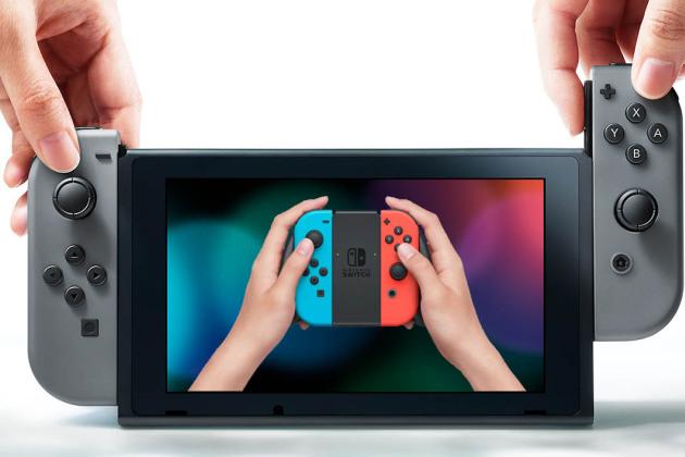 Sur cette photo : deux manettes Joy-Con et la tablette transportable