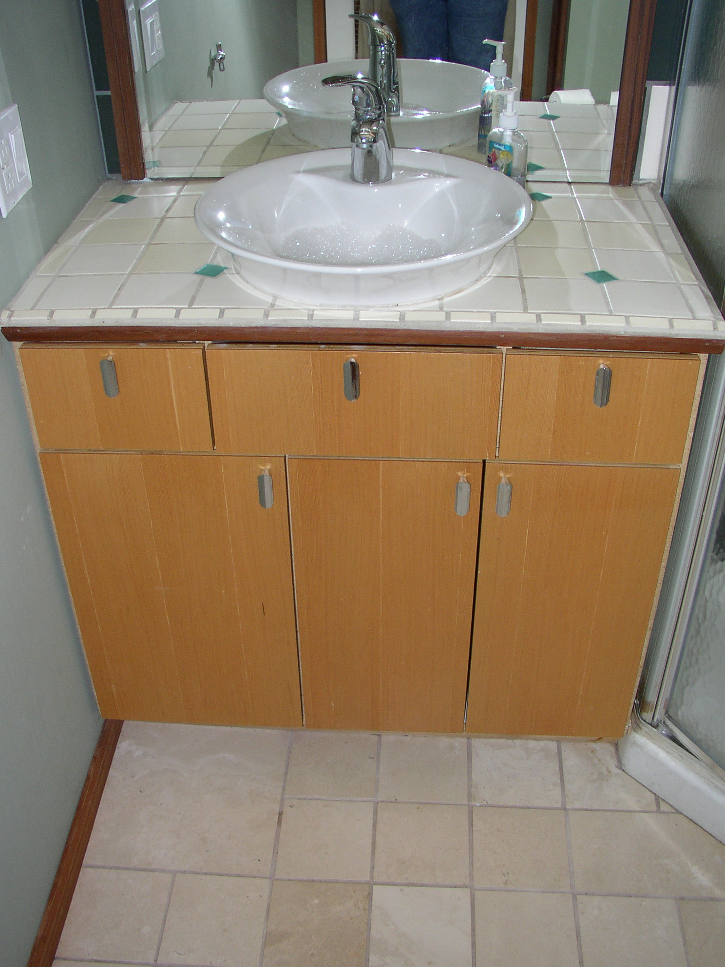 Wimsical tilework and CVG doors with reclaimed pulls