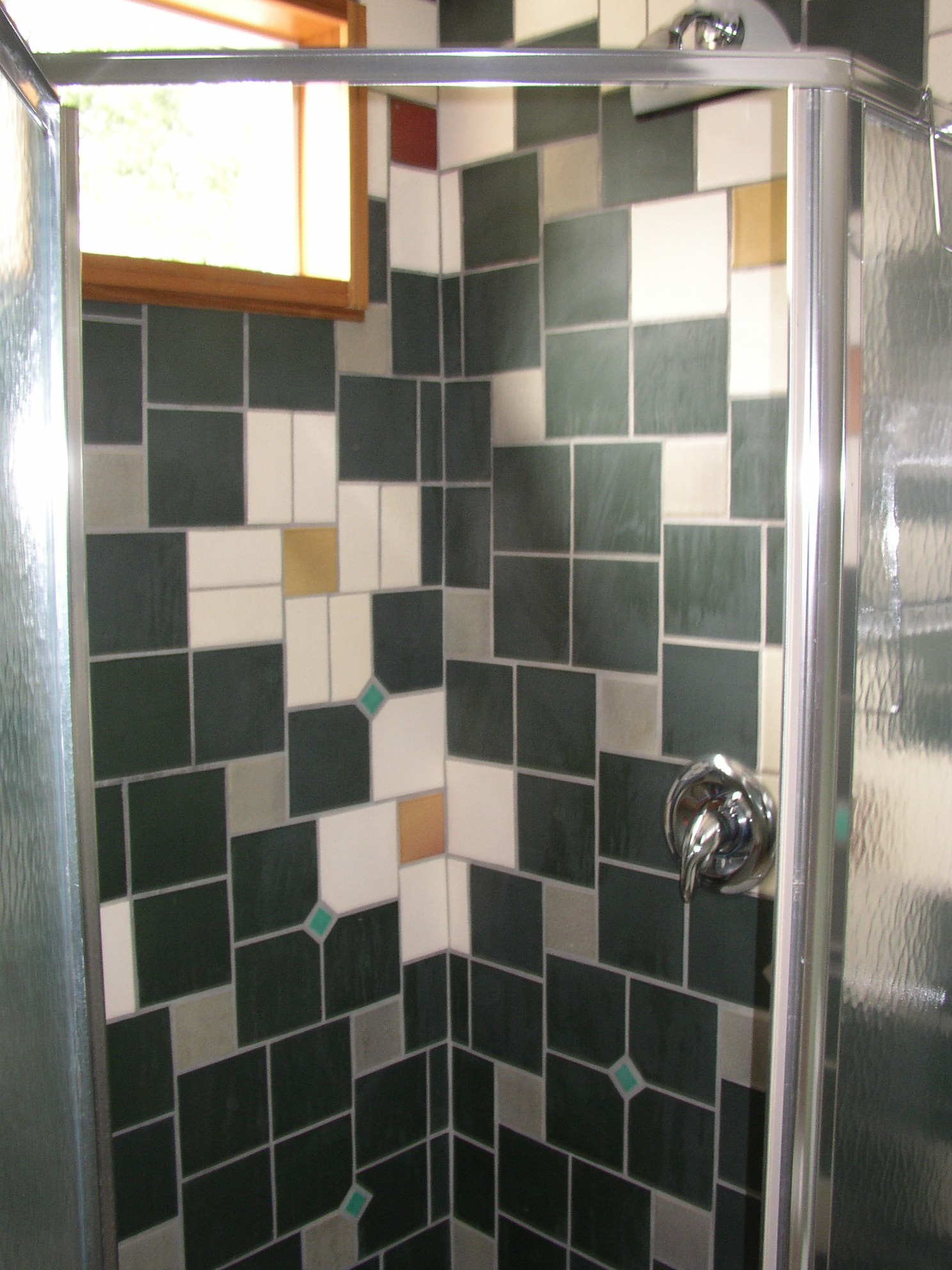 """We created mosaic """"flower"""" patterns with the Anne Saks tile we had"""