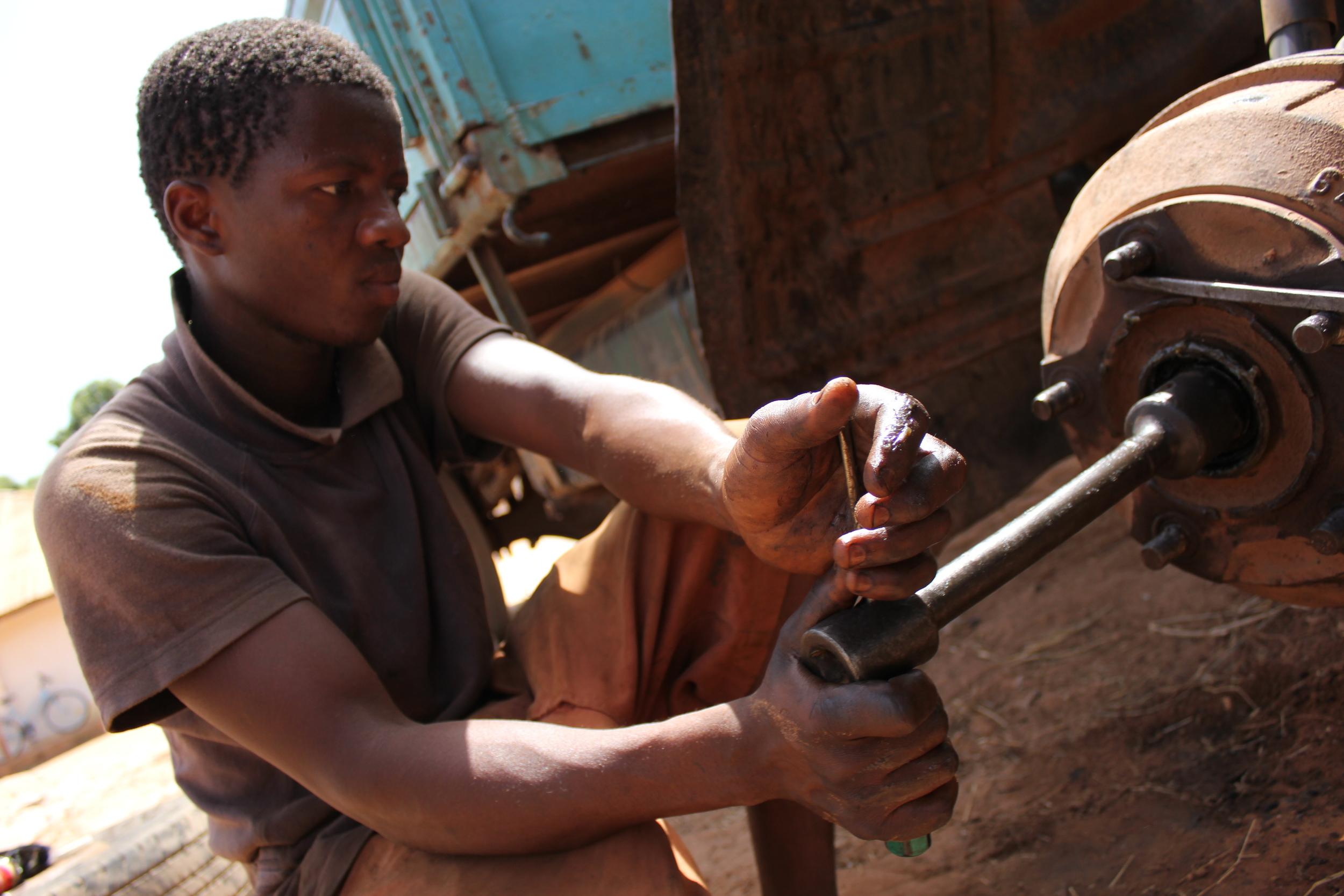 Auto mechanics student at West African Vocational Schools