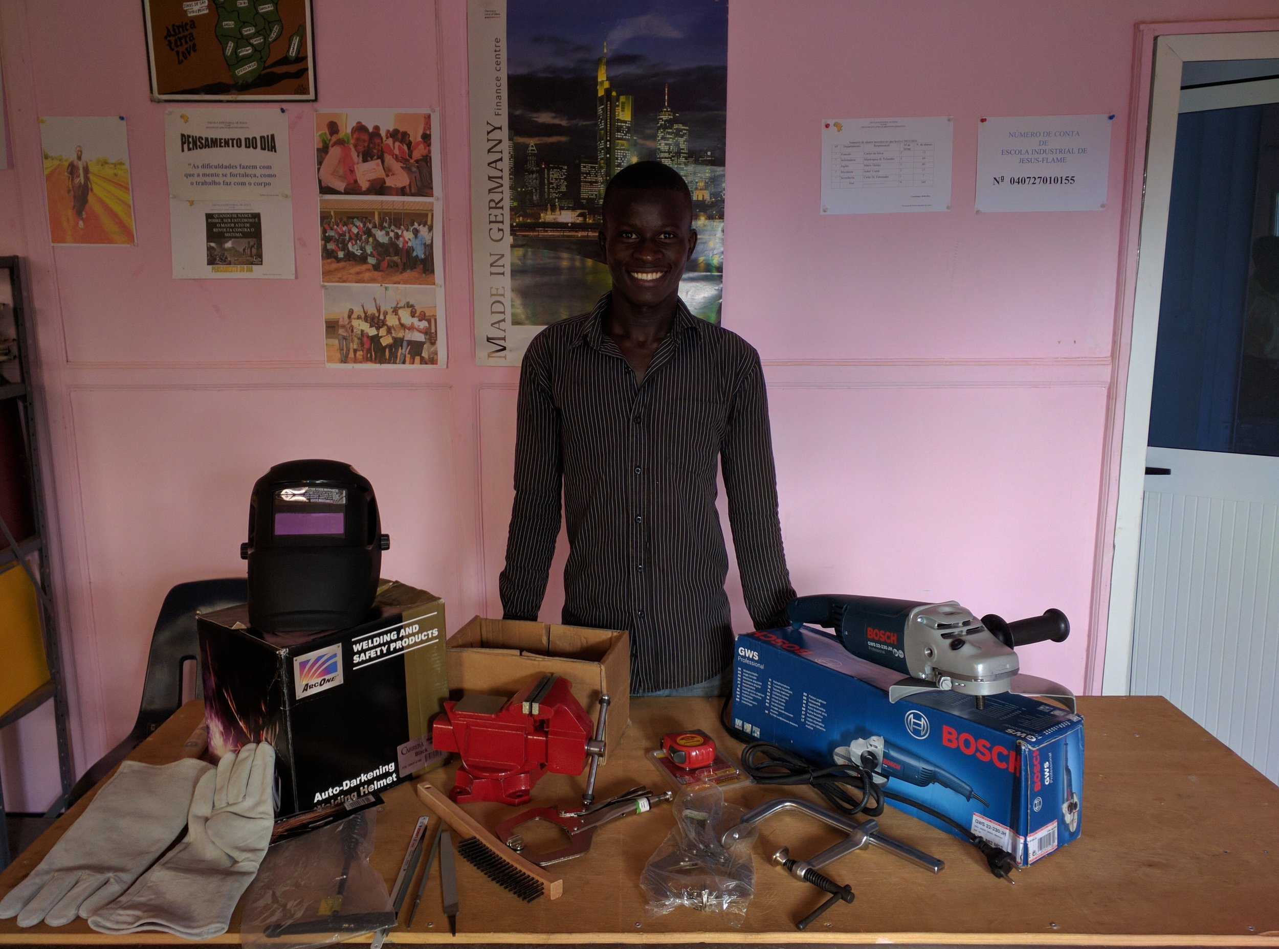 Welding graduate with tools from New Entrepreneur's Program kit