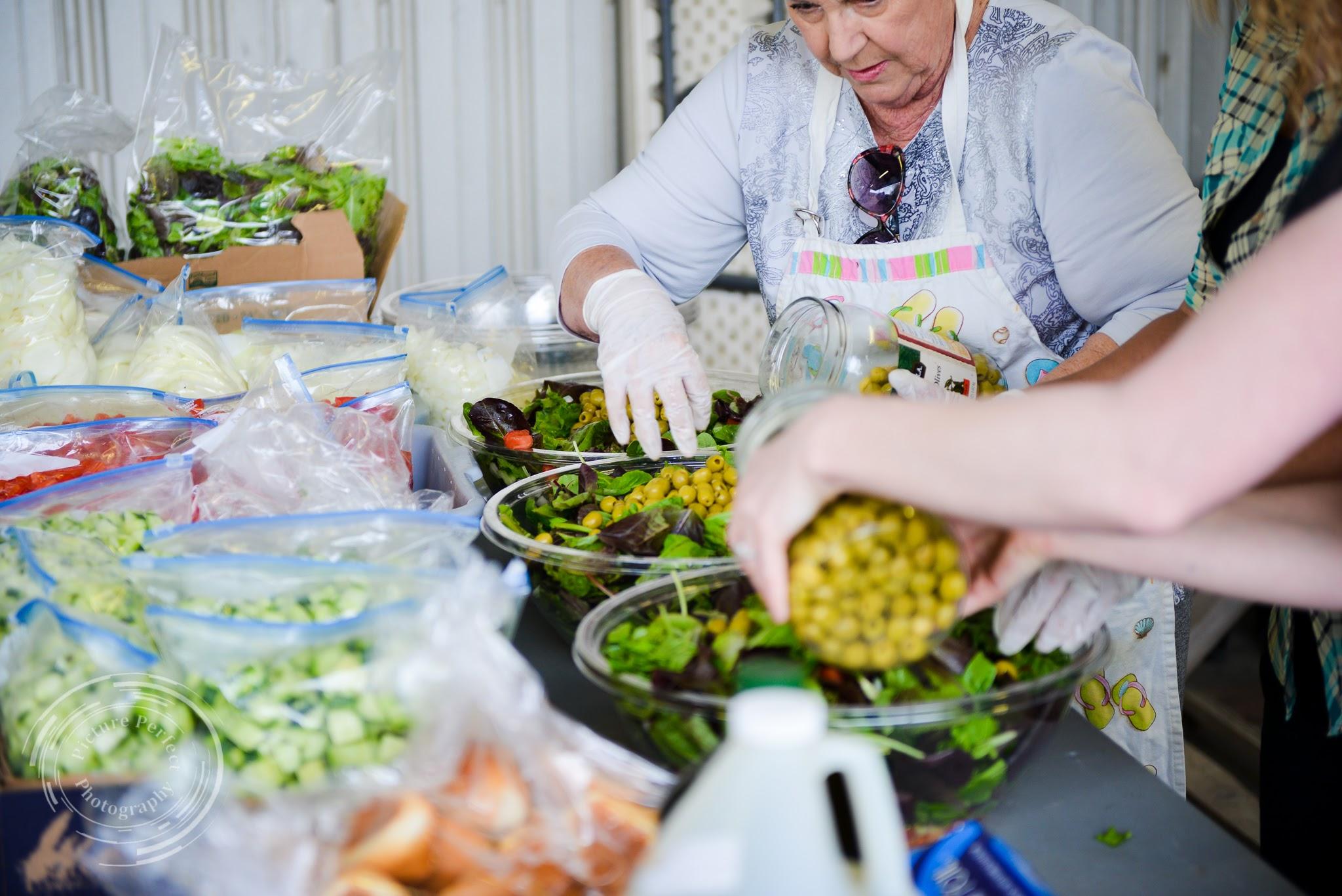 West African Vocational Schools event volunteers preparing food