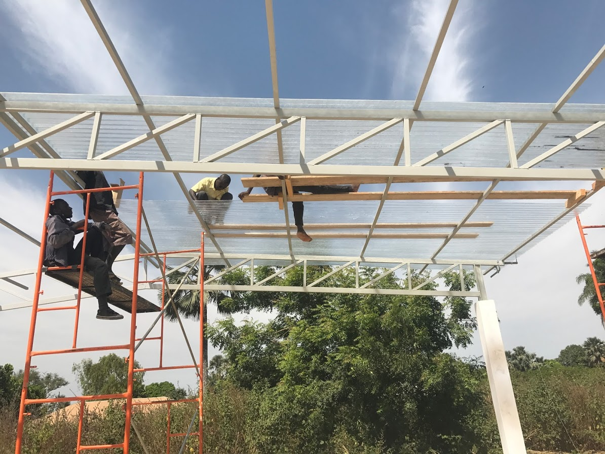 Welding department installing the roof on the cashew drying building for COAJOQ.JPG