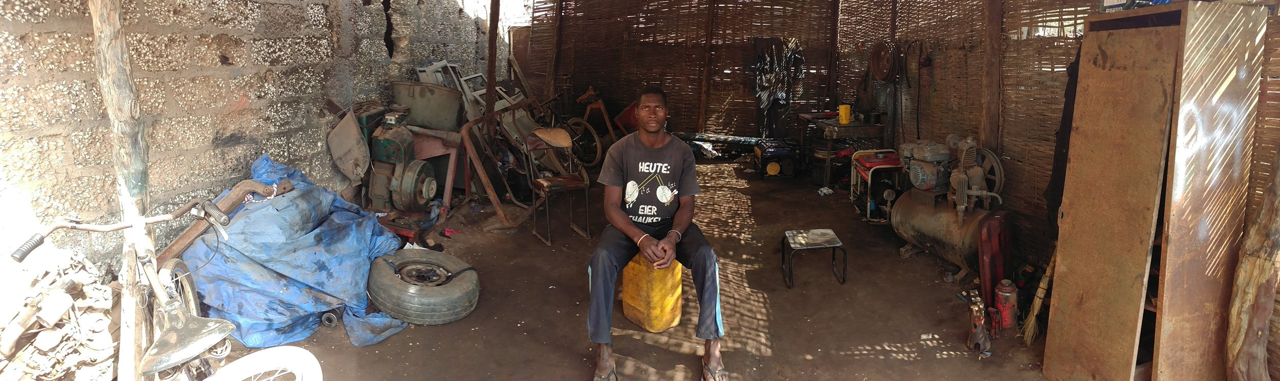 Bruno at the small thatch-covered roadside shop where he works.