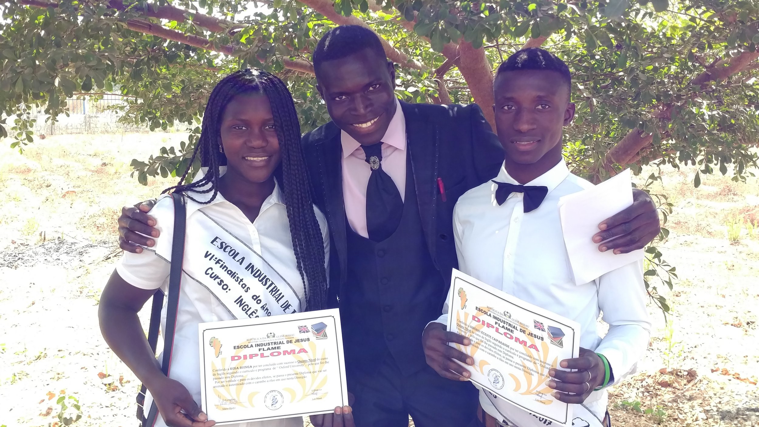 West African Vocational Schools English graduates and English teacher with diplomas