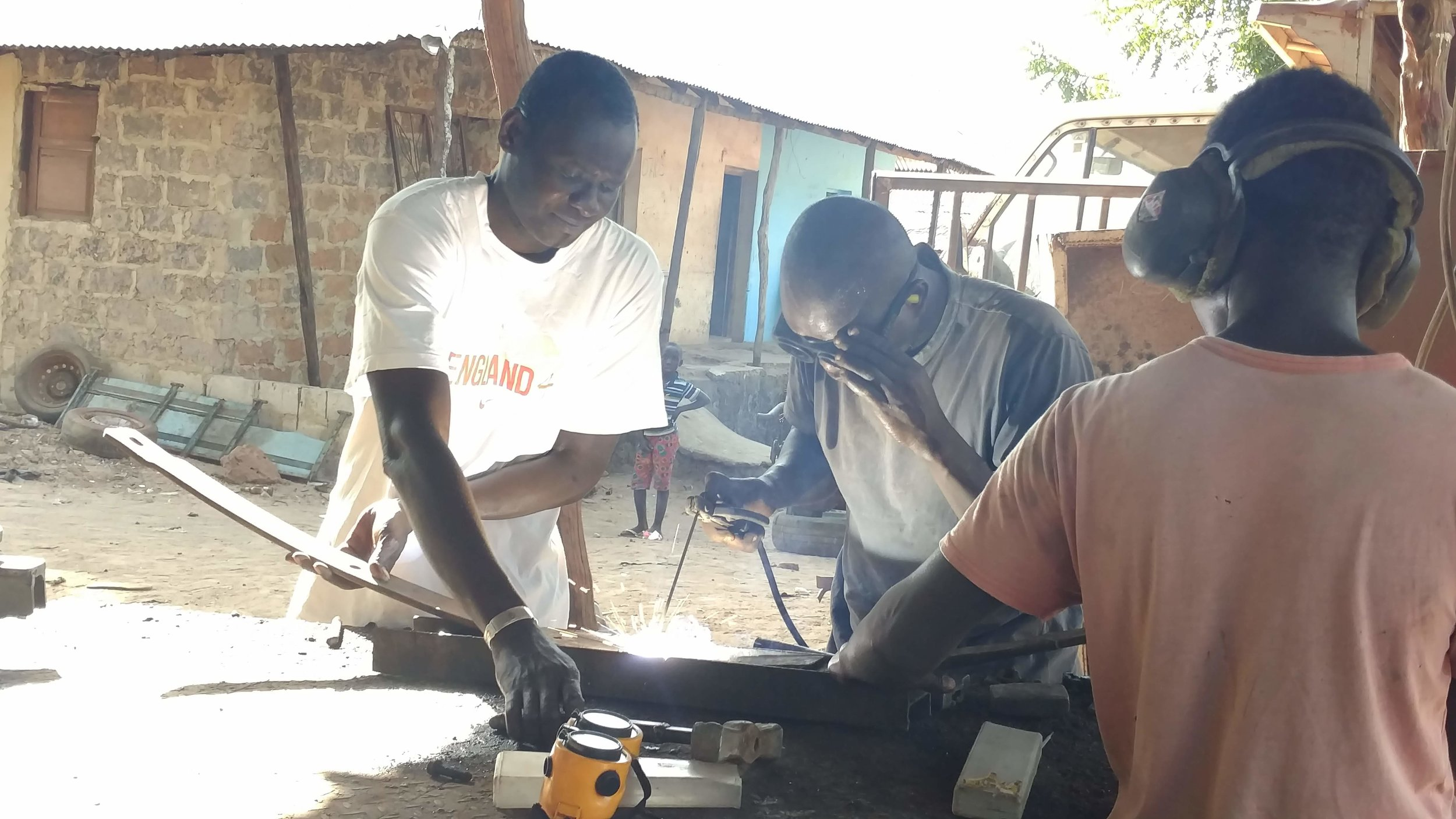 Sergio, center, welds together a piece of metal at a the local welding shop where he works. A few years ago, Sergio was unemployed and only made a few dollars here and there from working odd jobs. Determined to escape a life of poverty, he enrolled in the WAVS Vocational School's welding program.