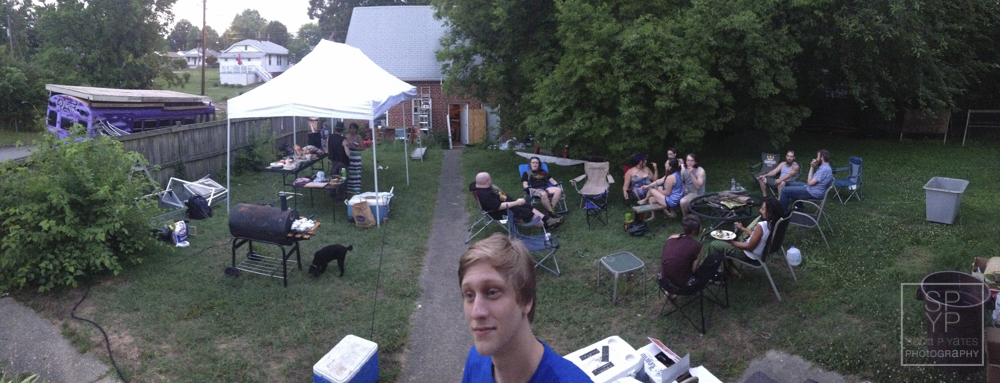 Brian poses in apanoramic view of the backyard during dinner.