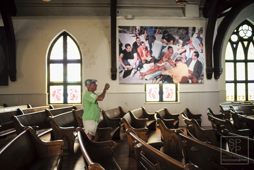 """A man photographs the exhibition of sports photographer, and one of the festival's featured artists,Walter Iooss called, """"The Sporting Life,"""" at The Haven in downtown Charlottesville, Va., on Saturday, June 13, 2015. (Photography by Scott P. Yates)"""