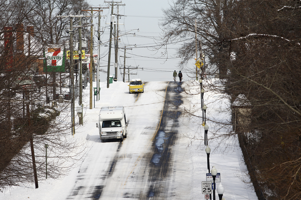 Vehicles and pedestrians proceed slowly along South Sycamore Street on Tuesday afternoon. Scott P. Yates/Progress-Index