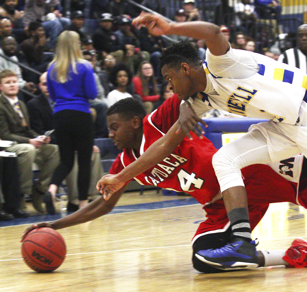 Matoaca's Stanley Taylor (24) and Hopewell's Daniel Saunders (14) dive for a loose ball during their game in Hopewell on Tuesday, January 13, 2015. Scott P. Yates/Progress-Index Photo