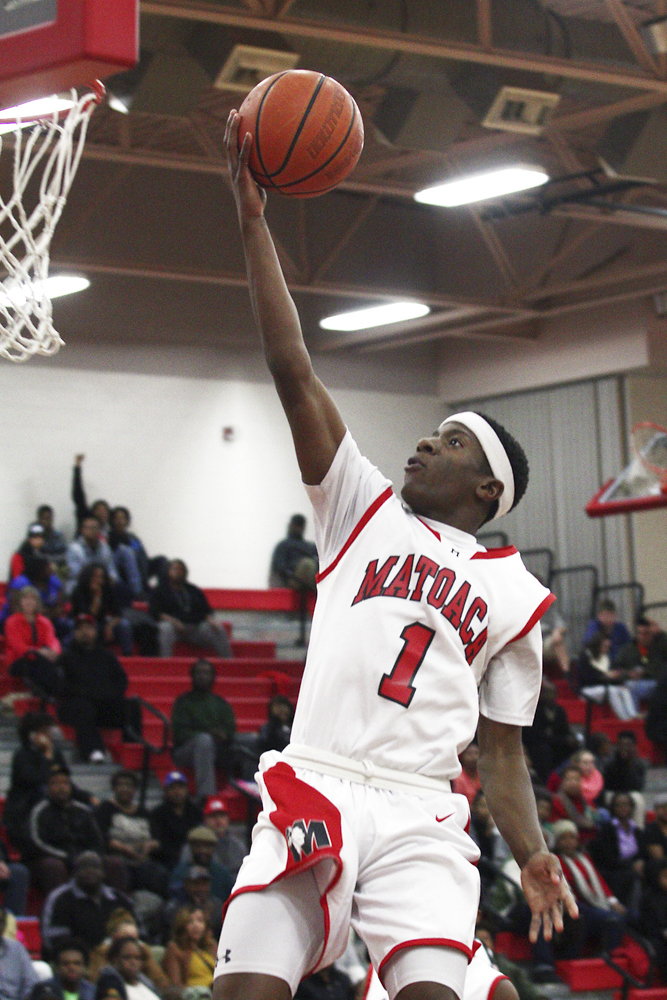 Matoaca High School's Myles Markland (1) goes for the rim against Prince George High School during their match in Chesterfield on Friday night. Scott P. Yates/Progress-Index Photo