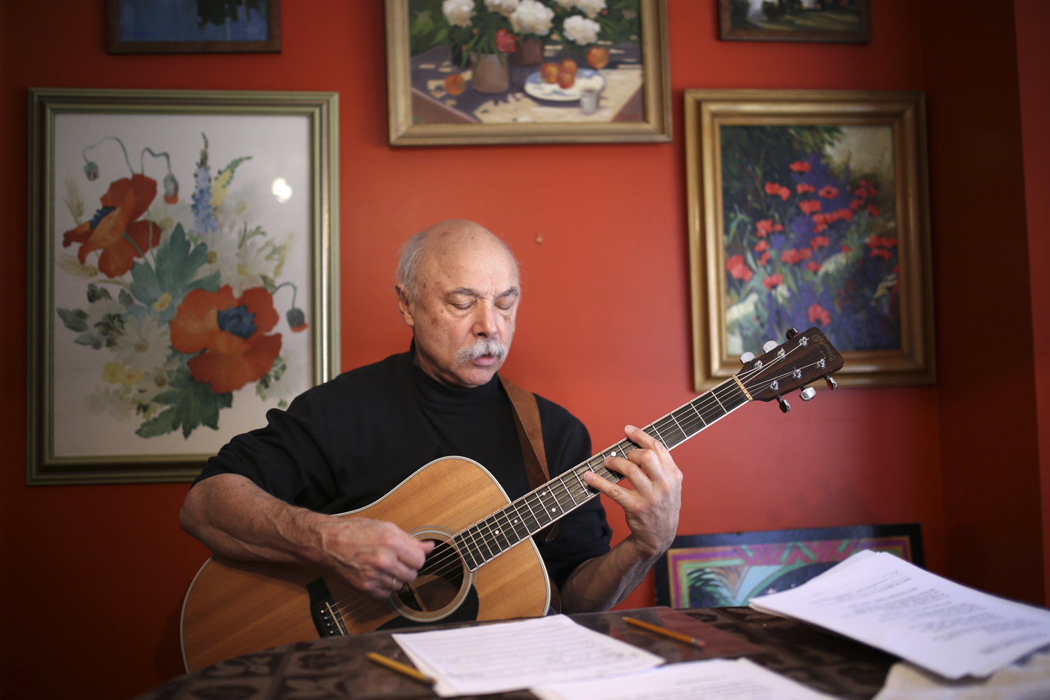 Dad Yates warms up on the guitar and reviews notes before facilitating a music lesson at his home on Feb. 2, 2017, in Salem, Va. [Photograph by Scott P. Yates]