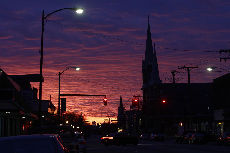 The setting sun sets the clouds above W. Washington Street ablaze in Petersburg on Friday, Feb. 10, 2017. [Scott P. Yates/progress-index.com]