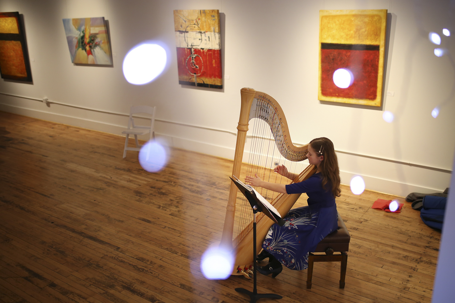 Elizabeth Johnson, 13, performs on the harp during Friday for the Arts! celebrations at The Ward Center for Contemporary Art in Petersburg on Friday, Feb. 10, 2017. [Scott P. Yates/progress-index.com]