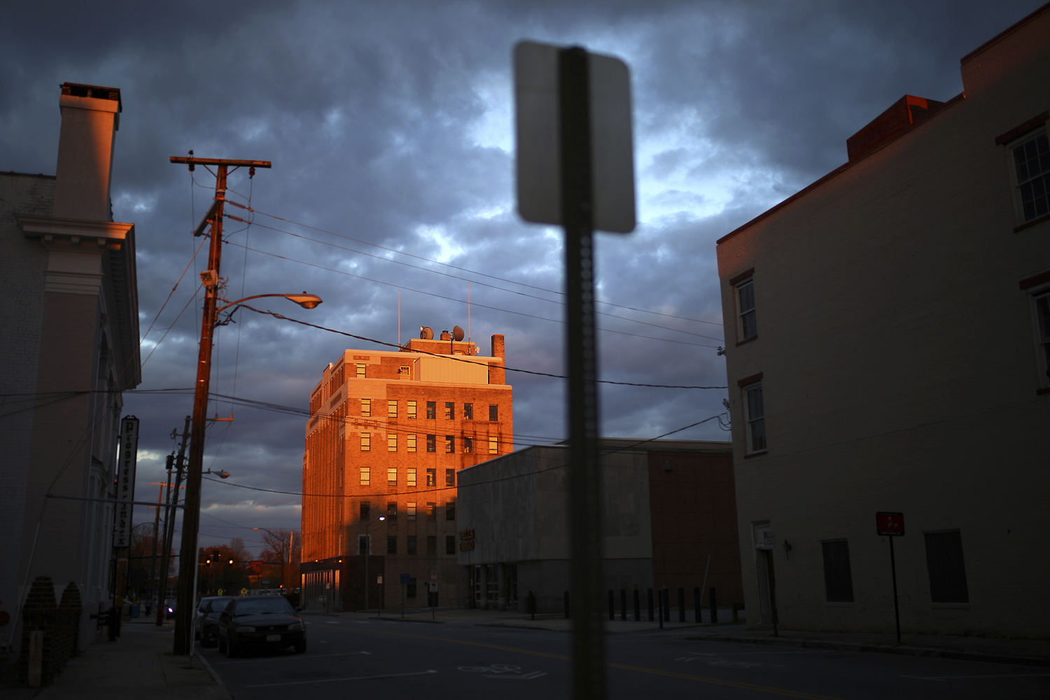 The sunset highlights the former BB&T bank building on Franklin and Adams Streets in Petersburg on Tuesday, March 14, 2017. [Scott P. Yates/progress-index.com]