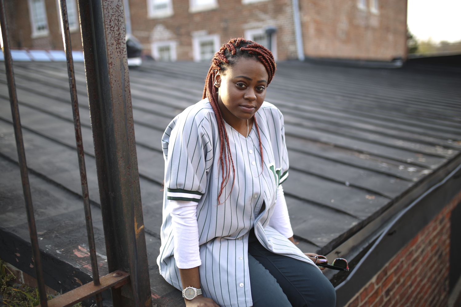 Neda Wright, a sophomore at Virginia State University, chats between poses while other VSU students, not pictured, conduct a photo shoot in the evening sun in an alleyway off E. Old Street in Petersburg on Tuesday, March 21, 2017. [Scott P. Yates/progress-index.com]