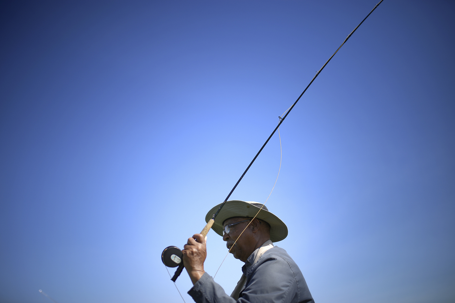 Norman Rankins, from Colonial Heights, casts a line during a Project Healing Waters Fly Fishing outting at Virginia State University's aquaculture ponds in Ettrick on Tuesday, April 11, 2017. [Scott P. Yates/progress-index.com]