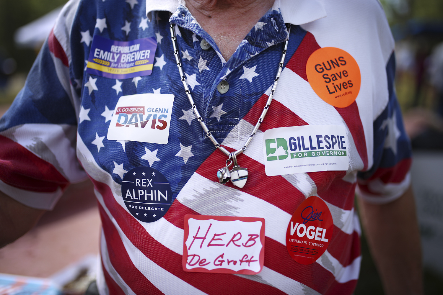 """Herb Groft, from Smithfield, shows off his support for candidates for state seats at The Shad, Grapes and Grains Festival. The Festival raised money for """"the good citizens of Wakefield, Virginia, and the surrounding rural area,"""" according to a statement by the organizers, at the Wakefield Ruritan Club on Friday, April 21, 2017. [Scott P. Yates/progress-index.com]"""