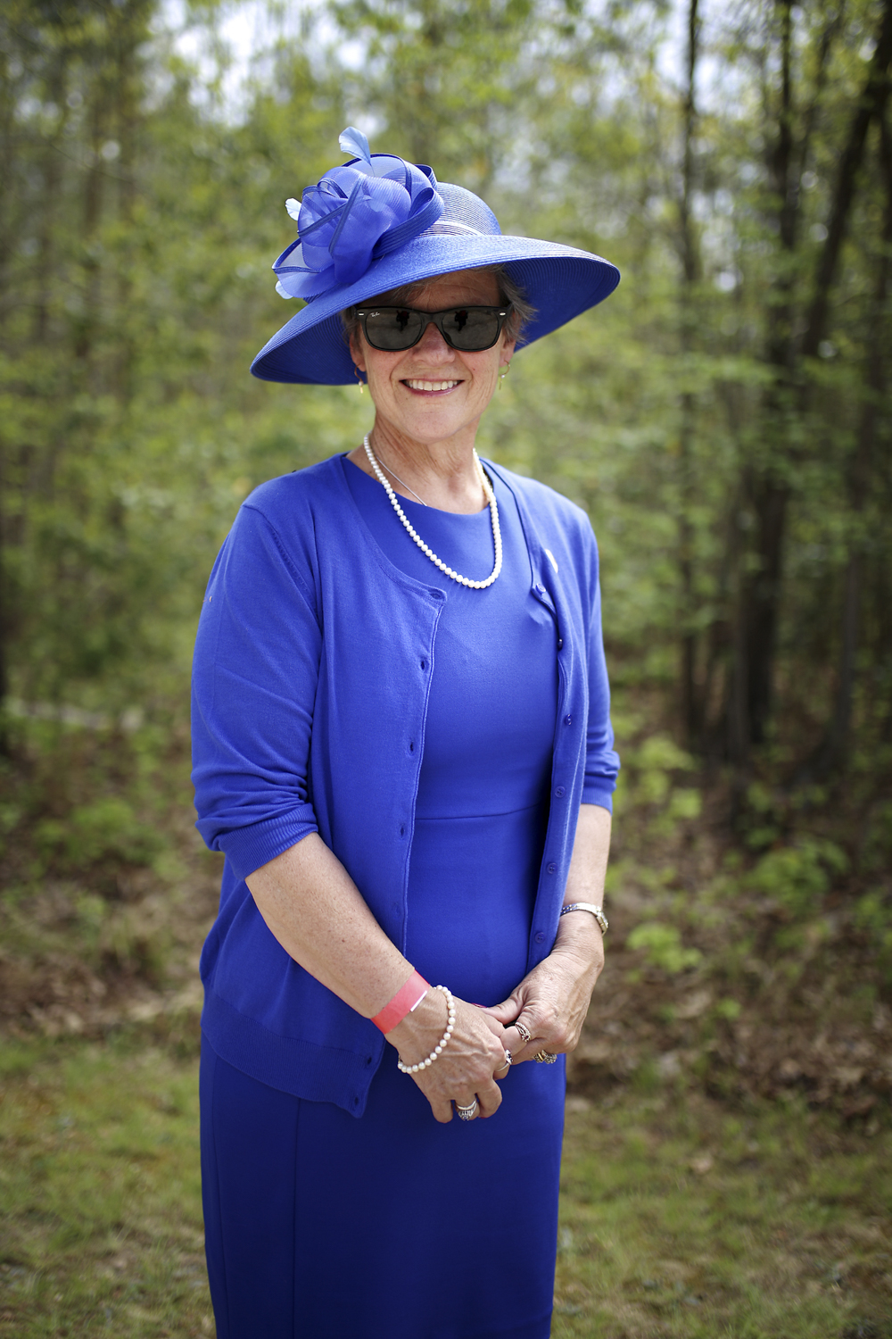 """Janet Taylor, of Chesterfield, sports a fashionable blue ensemble at The Shad, Grapes and Grains Festival. The Festival raised money for """"the good citizens of Wakefield, Virginia, and the surrounding rural area,"""" according to a statement by the organizers, at the Wakefield Ruritan Club on Friday, April 21, 2017. [Scott P. Yates/progress-index.com]"""