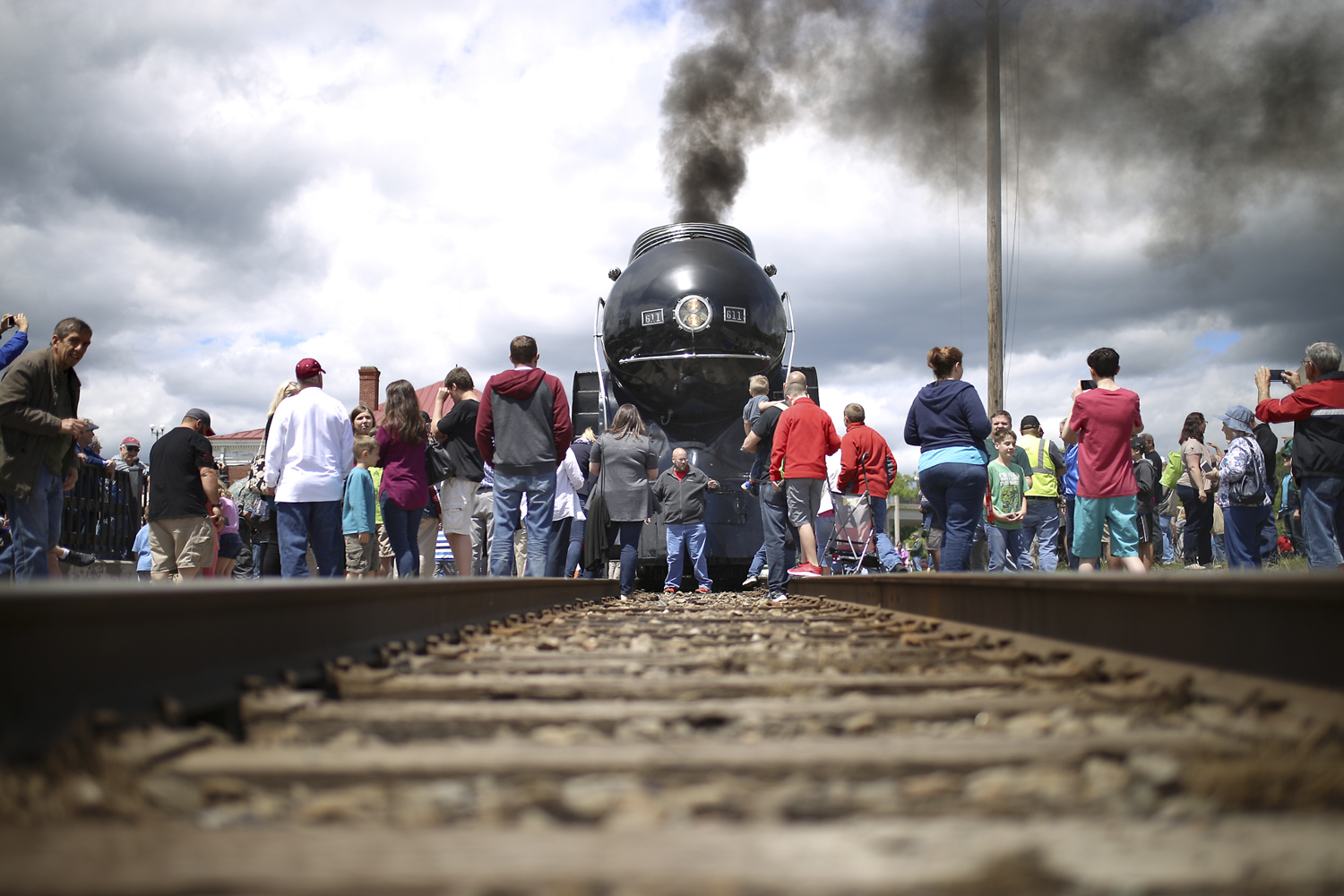 Onlookers surround the Class J steam locomotive Norfolk and Western 611 as it stops at Union Station for the first of two consecutive daily visits in Petersburg on Saturday, May 6, 2017. [Scott P. Yates/progress-index.com]