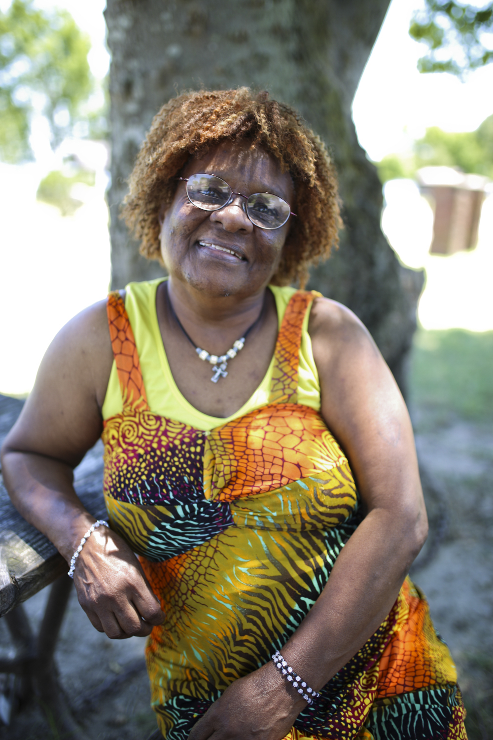 Margaret Swann, of Hopewell, rests in the shade after fishing at City Point Park in Hopewell on Wednesday, June 28, 2017. [Scott P. Yates/progress-index.com]