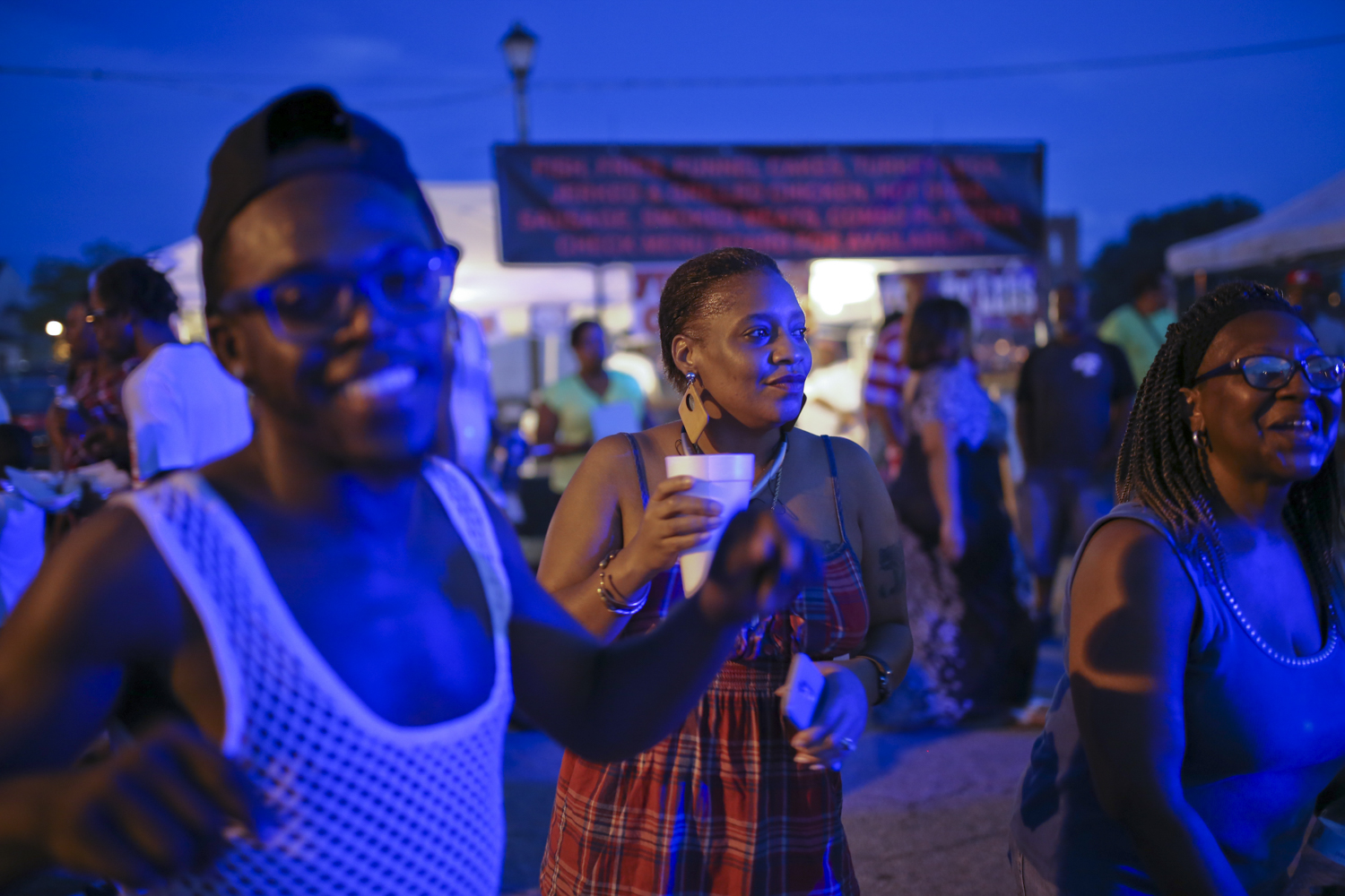 Friends, from left, Ryan Jones from Petersburg, Nikki Brown from Petersburg, and Sinnie Goodman from Petersburg, dance to a DJ at the 11th annual Halifax Music Festival in Petersburg on Friday, July 14, 2017. [Scott P. Yates/progress-index.com]