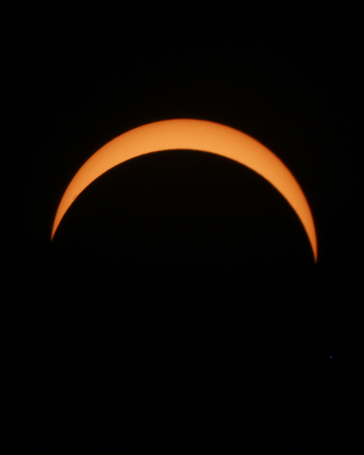 Using a special solar filter over the camera lens, the partial solar eclipse is seen at its peek at about 2:44 p.m. on August 21, 2017, on the Richard Bland College of William and Mary campus in Prince George, Va. [Scott P. Yates/progress-index.com]