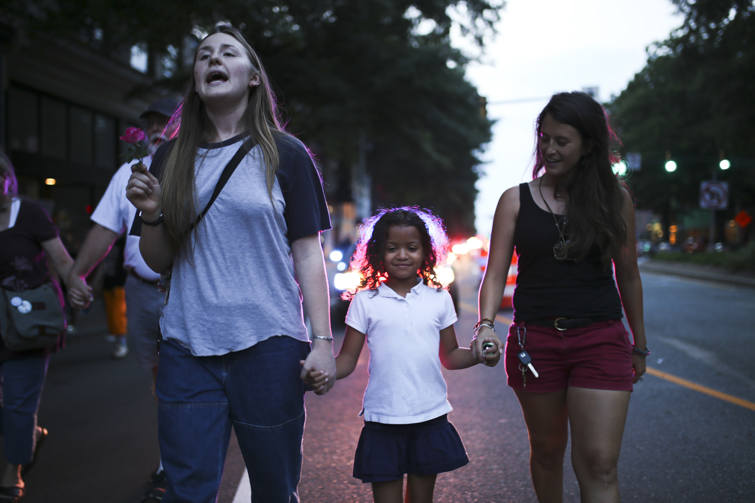 Marchers walk along Broad Street in Richmond during a protest against President Donald Trump's call to rescind the Deferred Action for Childhood Arrivals program in Richmond on Tuesday, Sept. 5, 2017. [Scott P. Yates/progress-index.com]