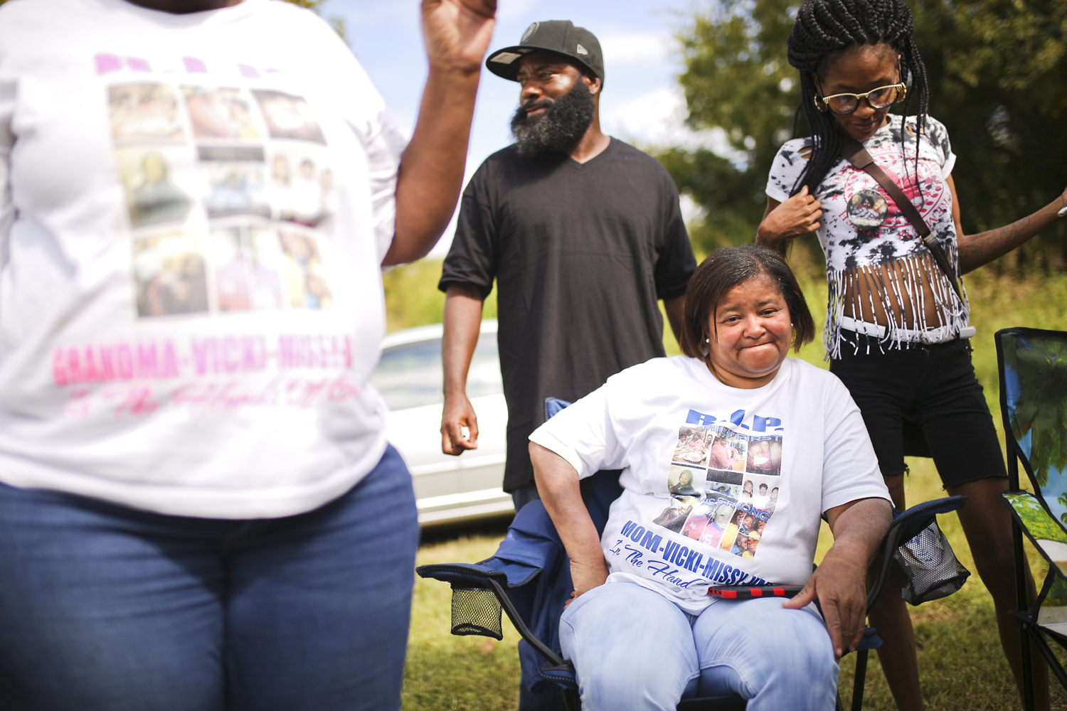 """Valerie Chavis-Jones, center, whose mother Pauline Wilkins and sister Vicki Ansar were killed along with two others in a quadruple murder in 2014, is sourrounded by family and friends on the site of Wilkins' former home where they were killed. Chavis-Jones and others gathered there on the afternoon following a jury's verdict finding their family member's killer guilty on all 10 counts of murder. After three years, """"we needed closure,"""" said Chavis-Jones. """"We feel that they are here with us."""" [Scott P. Yates/progress-index.com]"""