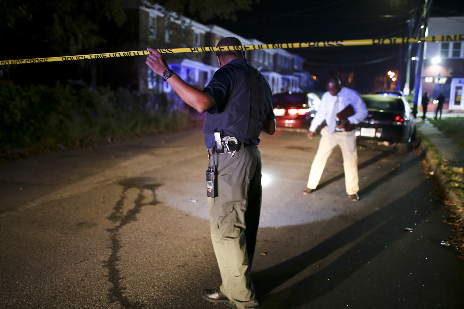 Petersburg Bureau of Police Lt. Emanuel Chambliss, center, and another detective investigate the scene where they believe five people were shot at about 9:30 p.m. at the intersection of Mistletoe and Harding Streets in Petersburg on Sunday, Sept. 17, 2017. [Scott P. Yates/progress-index.com]