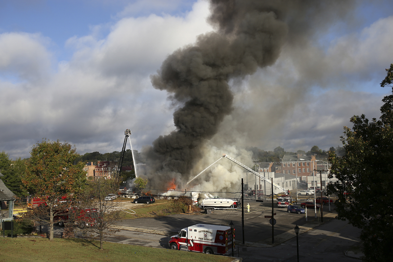 Petersburg firemen fight a blaze that leveled the Hotsy small engine repair building on Bank Street in Petersburg on Tuesday, Oct. 24, 2017. [Scott P. Yates/progress-index.com]