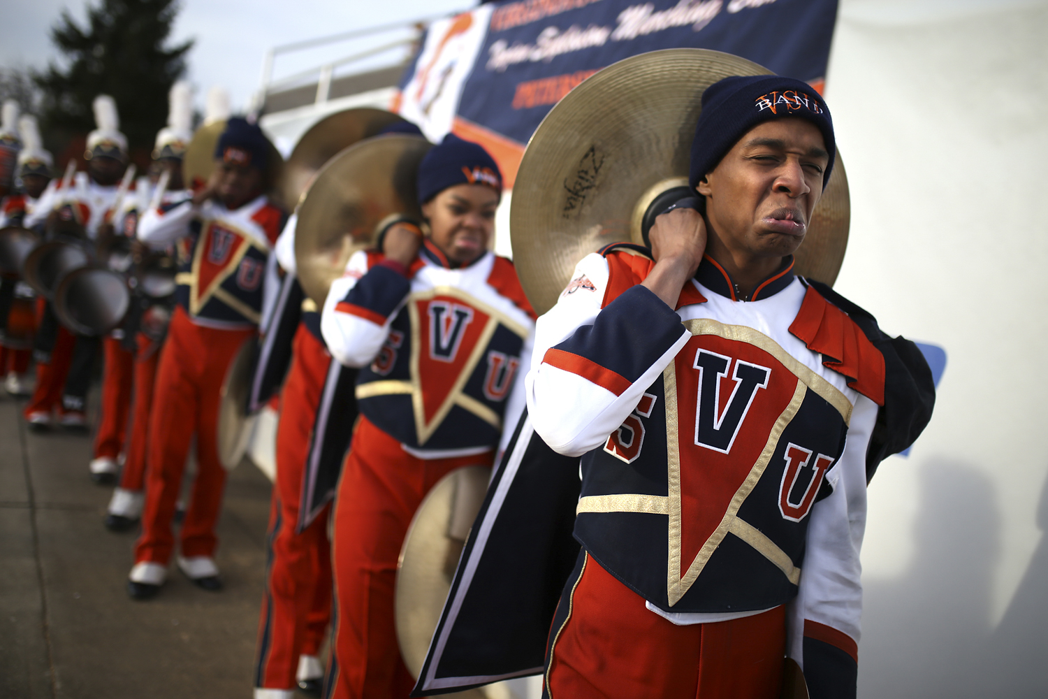 Virginia State University Trojan Explosion marching band members make intimidating faces as they march into Salem Stadium ahead of the CIAA conference championship football game against Fayetteville State University in Salem, Va., on Saturday, Nov. 11, 2017. [Scott P. Yates/progress-index.com]