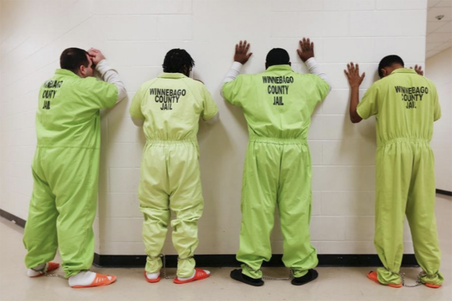 Inmates stand to prepare for transport on Dec. 7, 2017, at the Winnebago County Jail in Rockford, Illinois. [Scott P. Yates/rrstar.com staff]