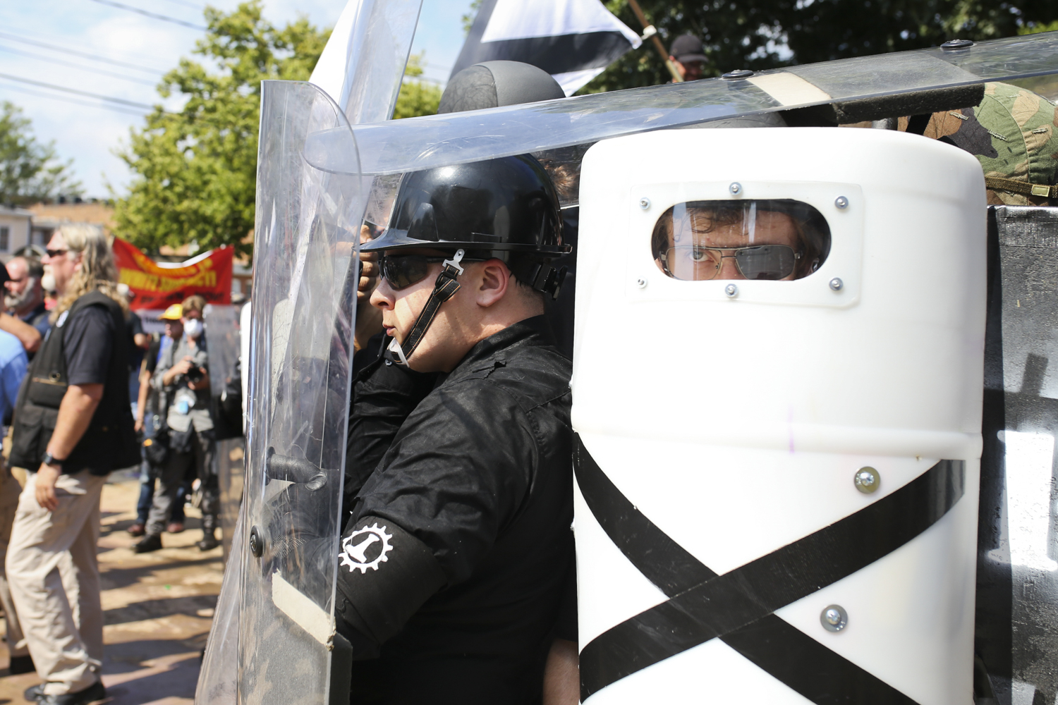 "Members with the ""Unite the Right"" hold a rally while counter protesters engage them at Emancipation Park in Charlottesville on Saturday, August 12, 2017. [Scott P. Yates/progress-index.com]"