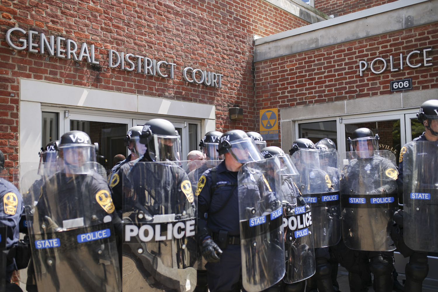 Virginia State Police surround the Charlottesville General District Court and police station when a press conference was scheduled by white supremacist Jason Kessler in Charlottesville, Va., on Sunday, August 13, 2017. [Scott P. Yates for The Wall Street Journal]