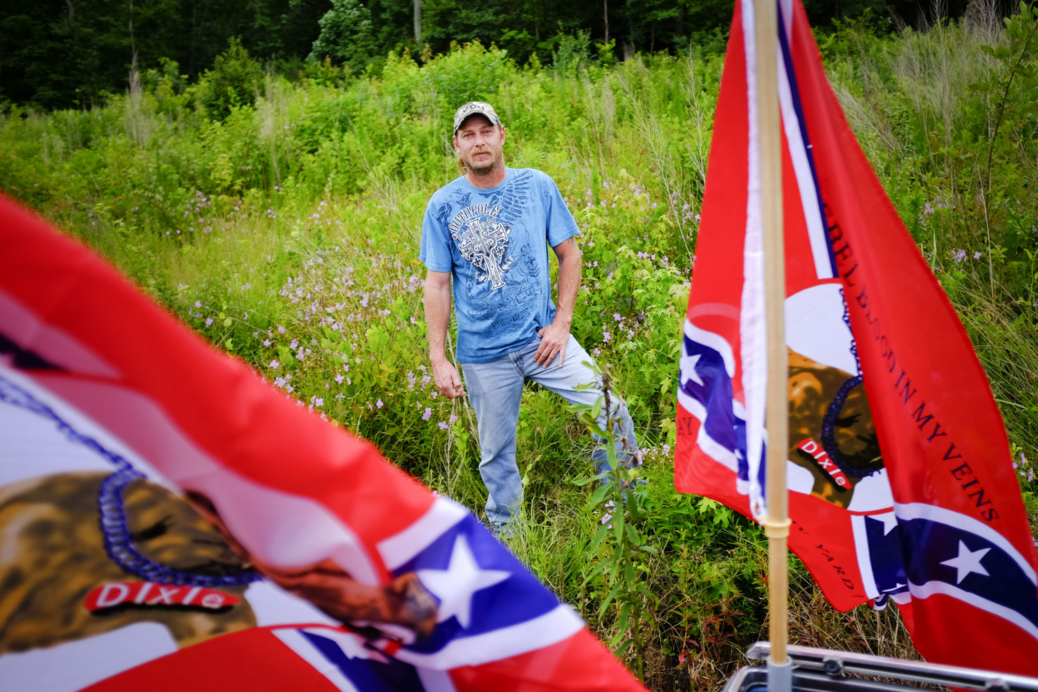 Steve Amos poses for a portrait with flags on the back of his 1983 El Camino vehicle before the start of the Flag Run 2015 in Matoaca, Va., on Saturday, July 11, 2015. Scott P. Yates/Progress-Index Photos