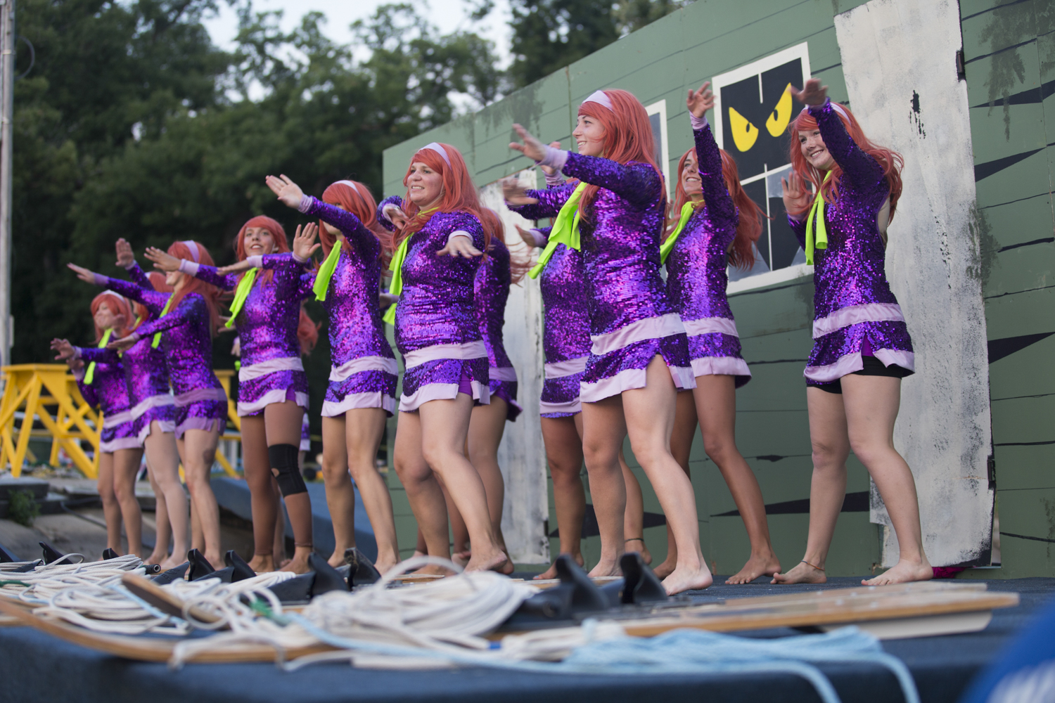 """Team members portraying the """"Daphne"""" character, perform the dock dance portion of the ballet line group. The ballet line comprises three dance elements: on the dock, on water skis, and stage dance back on shore. [SCOTT P. YATES/RRSTAR.COM STAFF]"""